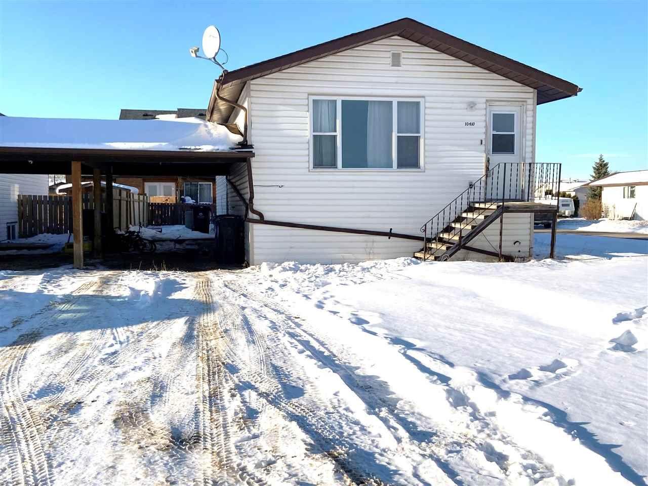 Main Photo: 10410 88A Street in Fort St. John: Fort St. John - City NE 1/2 Duplex for sale (Fort St. John (Zone 60))  : MLS®# R2520340