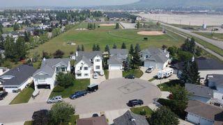 Photo 45: 426 Riverview Green: Cochrane Detached for sale : MLS®# A1132015