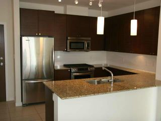 """Photo 2: 418 101 MORRISSEY Road in Port Moody: Port Moody Centre Condo for sale in """"LIBRA AT SUTERBROOK"""" : MLS®# V1056915"""
