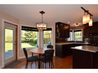 Photo 12: 148 GLENEAGLES Close: Cochrane House for sale : MLS®# C4010996