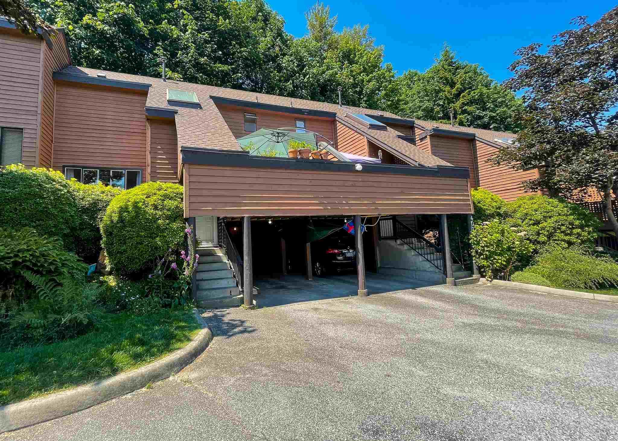 """Main Photo: 405 CARDIFF Way in Port Moody: College Park PM Townhouse for sale in """"EASTHILL"""" : MLS®# R2598640"""