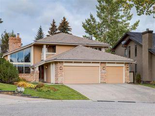 Photo 1: 308 COACH GROVE Place SW in Calgary: Coach Hill House for sale : MLS®# C4064754