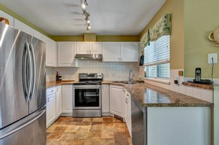 """Photo 12: 506 13900 HYLAND Road in Surrey: East Newton Townhouse for sale in """"HYLAND GROVE"""" : MLS®# R2595729"""