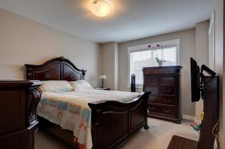 Photo 19: 15 West Coach Manor SW in Calgary: West Springs Row/Townhouse for sale : MLS®# A1100327