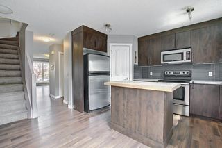 Photo 5: 49 Aspen Hills Drive in Calgary: Aspen Woods Row/Townhouse for sale : MLS®# A1108255