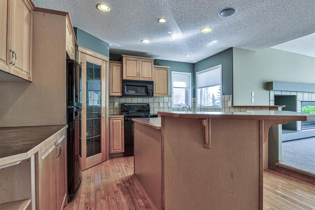Photo 6: Photos: 106 Everwillow Close SW in Calgary: Evergreen Detached for sale : MLS®# A1116249