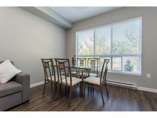 """Photo 9: 210 6490 194 Street in Surrey: Clayton Condo for sale in """"WATERSTONE ESPLANADE GRANDE"""" (Cloverdale)  : MLS®# R2603405"""