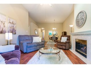 """Photo 6: 106 19649 53 Avenue in Langley: Langley City Townhouse for sale in """"Huntsfield Green"""" : MLS®# R2595915"""