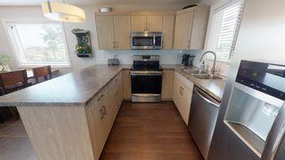 """Photo 8: 8320 88 Street in Fort St. John: Fort St. John - City SE 1/2 Duplex for sale in """"MATTHEWS PARK"""" (Fort St. John (Zone 60))  : MLS®# R2602097"""