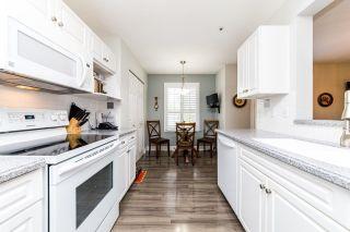 "Photo 9: 206 13870 70 Avenue in Surrey: East Newton Condo for sale in ""CHELSEA GARDENS"" : MLS®# R2591280"