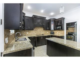 Photo 9: 5922 131A Street in Surrey: Panorama Ridge House for sale : MLS®# R2595803