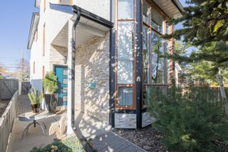 Main Photo: 256 22 Avenue NW in Calgary: Tuxedo Park Detached for sale : MLS®# A1156108