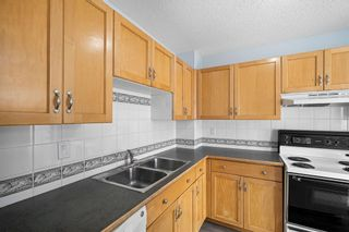 Photo 4: 19 116 Silver Crest Drive NW in Calgary: Silver Springs Row/Townhouse for sale : MLS®# A1118280