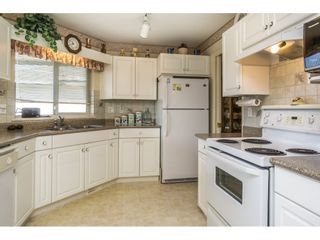 """Photo 7: 102 31406 UPPER MACLURE Road in Abbotsford: Abbotsford West Townhouse for sale in """"Estates of Ellwood"""" : MLS®# R2113152"""