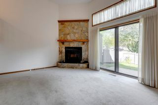 Photo 3: 100 23 Glamis Drive SW in Calgary: Glamorgan Row/Townhouse for sale : MLS®# A1056750