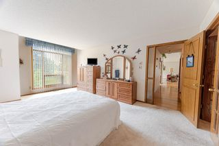 Photo 13: 126 Country Club Lane in Rural Rocky View County: Rural Rocky View MD Semi Detached for sale : MLS®# A1129942
