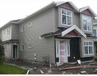 Photo 1: 452 E 44TH Avenue in Vancouver: Fraser VE 1/2 Duplex for sale (Vancouver East)  : MLS®# V681165