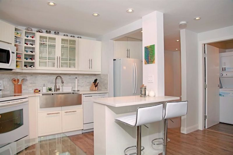 FEATURED LISTING: 104 - 936 BUTE Street Vancouver