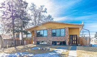 Photo 2: 2403 43 Street SE in Calgary: Forest Lawn Duplex for sale : MLS®# A1082669