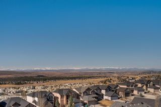 Photo 3: 244 Springbluff Heights SW in Calgary: Springbank Hill Detached for sale : MLS®# A1094759