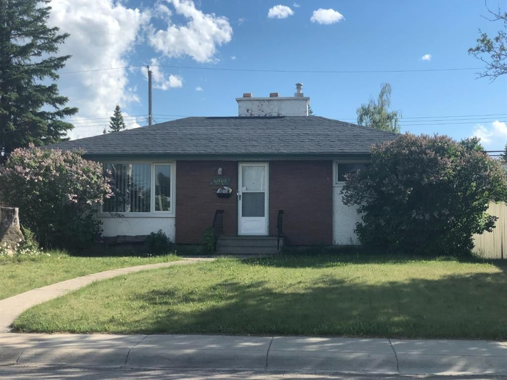 Main Photo: 5039 WAVERLEY Drive SW in Calgary: Westgate Detached for sale : MLS®# A1121075