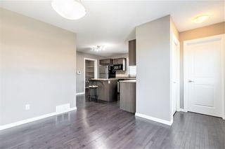 Photo 9: 8218 180 Avenue in Edmonton: Zone 28 House Half Duplex for sale : MLS®# E4253610