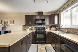 Photo 9: 94 SUNSET Road: Cochrane House for sale : MLS®# C4147363