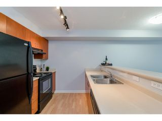 """Photo 5: 209 5465 203 Street in Langley: Langley City Condo for sale in """"Station 54"""" : MLS®# R2394003"""