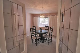 Photo 16: 15 Coach Side Terrace SW in Calgary: Coach Hill Row/Townhouse for sale : MLS®# A1071978