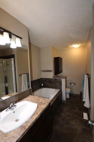 Photo 16: 151 Silverado Drive SW in Calgary: Silverado Detached for sale : MLS®# A1124527