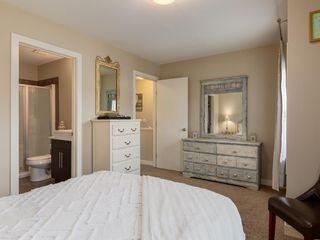 Photo 17: 438 Quarry Villas SE in Calgary: Douglasdale/Glen Row/Townhouse for sale : MLS®# A1057271