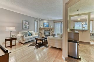 Photo 5: 85 Coachway Gardens SW in Calgary: Coach Hill Row/Townhouse for sale : MLS®# A1110212