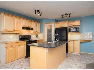 Photo 7: 150 BRIDLECREEK Park SW in Calgary: Bridlewood House for sale : MLS®# C4086800