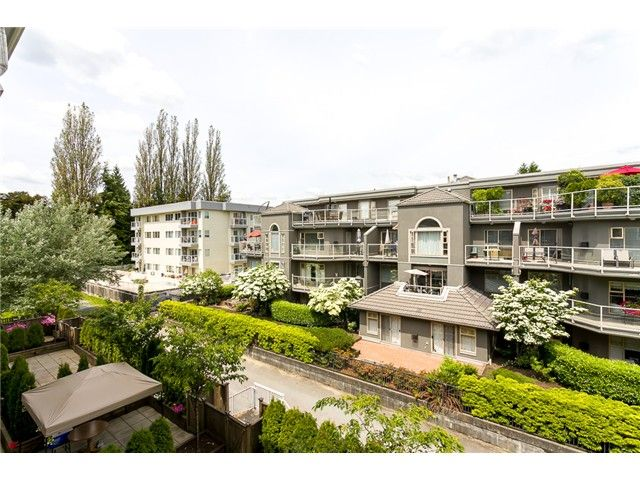 """Main Photo: 306 2373 ATKINS Avenue in Port Coquitlam: Central Pt Coquitlam Condo for sale in """"CARMANDY"""" : MLS®# V1069079"""