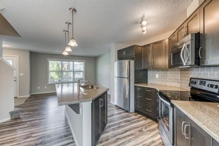 Photo 2: 68 Sunvalley Road: Cochrane Row/Townhouse for sale : MLS®# A1126120