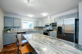 Photo 13: 88 Strathlorne Crescent SW in Calgary: Strathcona Park Detached for sale : MLS®# A1097538