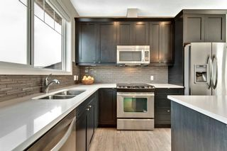 Photo 2: 8 NOLAN HILL Heights NW in Calgary: Nolan Hill Row/Townhouse for sale : MLS®# A1015765