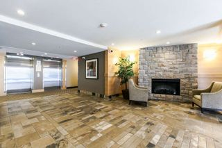 "Photo 2: 322 700 KLAHANIE Drive in Port Moody: Port Moody Centre Condo for sale in ""BOARDWALK"" : MLS®# R2039030"