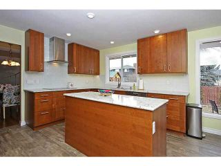 Photo 4: 116 LAKE PLACID Road SE in Calgary: Lk Bonavista Estates Residential Detached Single Family for sale : MLS®# C3654638