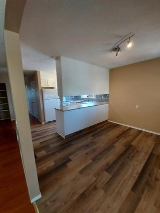 Photo 8: 2 Edgedale Court NW in Calgary: Edgemont Semi Detached for sale : MLS®# A1129985