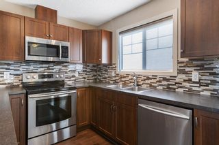 Photo 11: 122 Sunset Road: Cochrane Row/Townhouse for sale : MLS®# A1127717