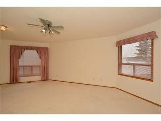 Photo 7: 12 WEST COPITHORNE Place: Cochrane House for sale : MLS®# C4049219