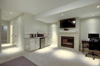 Photo 31: 309 26 Avenue NE in Calgary: Tuxedo Park Semi Detached for sale : MLS®# A1070057