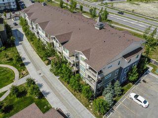 Photo 2: 2101 4 Kingsland Close SE: Airdrie Apartment for sale : MLS®# A1117201