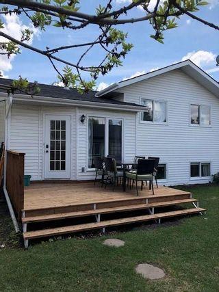 Photo 2: 959 MCKENZIE Drive SE in Calgary: McKenzie Lake House for sale : MLS®# C4183479