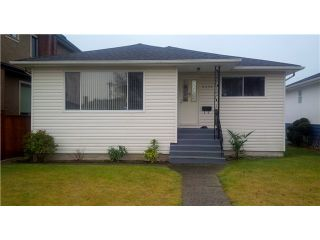 Photo 1: 2450 E 53RD Avenue in Vancouver: Killarney VE House for sale (Vancouver East)  : MLS®# V1042493