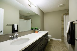 Photo 10: 30 SILVERADO CREST Bay SW in Calgary: Silverado Detached for sale : MLS®# A1019218