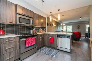 "Photo 4: 104 2110 ROWLAND Street in Port Coquitlam: Central Pt Coquitlam Townhouse for sale in ""AVIVA ON THE PARK"" : MLS®# R2168071"