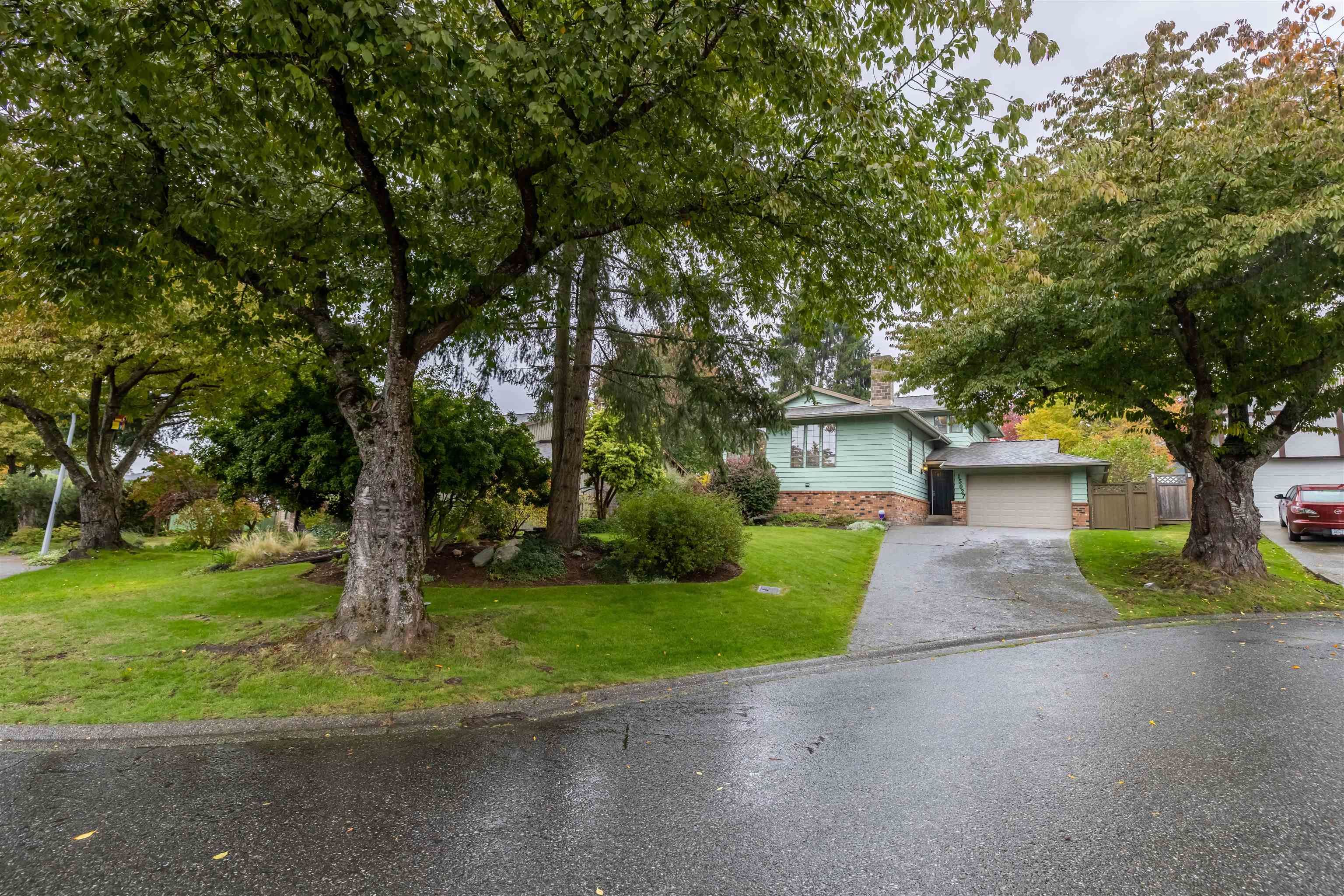 Main Photo: 15027 SPENSER Drive in Surrey: Bear Creek Green Timbers House for sale : MLS®# R2625533