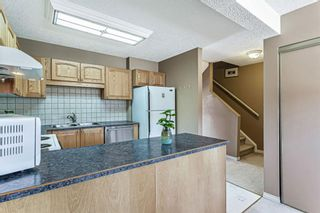 Photo 10: 1413 Ranchlands Road NW in Calgary: Ranchlands Row/Townhouse for sale : MLS®# A1133329